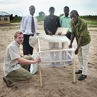 The Board of Mongu District Farmers Association and Patrick with a low-cost solar dryer constructed as part of a food processing workshop.