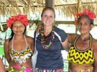 Volunteer Kyra Stenslie and some of the community members in the Embera village of Tusipono.