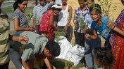 Here, school students in Nepal pack out tree seedlings.