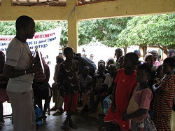 Community members learn about how to protect themselves from malaria