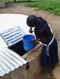 Girl fetches water from her school's well