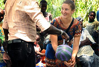 Peace Corps Volunteer Lindsay Swisher showing proper hand washing in her village, Saare Aladji, in Senegal's Tambacounda region, during the Ebola prevention/W.A.S.H. training.