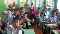 Peace Corps volunteer Vinh Van Le poses with his students