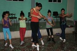 PCV teaches girls in her community ballet techniques
