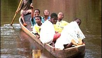 Children from a local village chauffeur people across the Nero River in a wooden canoe called a pirogue. This is the only means of transportation from Grand-Bereby to the villages of Nero 1 and Nero 2.