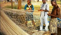 Emmanuel and Stephen Francis take great care to repair their fishing nets. Fishing in the coastal waters provides them with income and food.