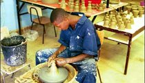 This young man is involved making pottery, an industry in which water is an important ingredient.