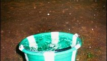 This bucket in front of my house is collecting rain water on one of the many rainy days of the wet season.