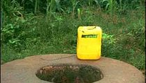 People use the yellow bidon for drawing water out of the well. Before being used in this manner, the bidon could have contained vegetable oil, gasoline, car oil, or other substances.
