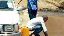 I watch as my local friend Calvin takes water for his family from the Ewaso Nyiro River. He is filling jerry cans that will last two days. Even though the water is very dirty, it will be used for everything.