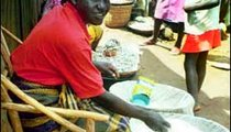 Mama Mary Achieng sells rice in the market. Rice, which needs a great deal of water to grow, is a major food product of Kenya.