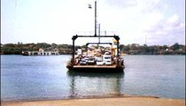 """During """"rush hour"""" in Mombasa, three ferries run to and from the south coast. At other times only one or two are in service."""