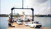 Drivers leave the ferry on the southern tip of Mombasa Island.
