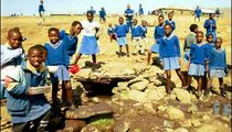 The children of Ha Sekhohola Primary School gather around the citibeng, or borehole, to fetch water between classes.