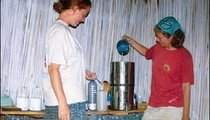 My Peace Corps colleague Julie Bednarski (left) and I take steps to purify our water. Here, I pour the water into a container that has a filter, while Julie prepares to add chlorine. We are in Julie's home in Tamboro, in southeast Madagascar.