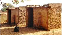 These eight-year-old school latrines which were built as a joint effort on the part of Peace Corps Volunteers and villagers in 1991.