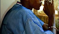Mbaye Sumb, my host family brother, enjoys a glass of minty tea.