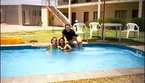 On a trip to Oshakati Town, PCVs Tracy Reines (center), Maggie Bartlett (right), and I enjoy a dip in the pool at the hotel.