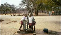 Learners at this school are collecting water for trees planted on school grounds. The tap is locked after school hours and the key is kept with the janitor.