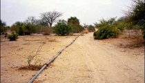 This water pipeline runs above the ground for about 10 kilometers, supplying water to villages in the area.