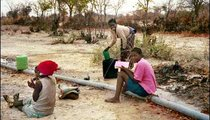 These women are fetching water from a broken part of the pipeline. Sometimes the pipe just breaks from wear, other times people break it to get water for themselves or their animals.