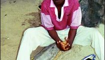 Seventeen-year-old Bachirou demonstrates the ritual pre-prayer washing that Muslims do five times a day.