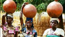 Women return home from the pump, carefully balancing clay jars full of water on their heads. Clay jars actually keep water cooler than jars made from other materials.