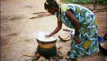Belle Ba prepares millet couscous for her family by steaming the pounded grain.