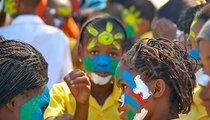 This photo was taken at the national celebration of Namibia's 20th year of independence, which was held in our town. The children's faces are painted in the colors of the Namibian flag.