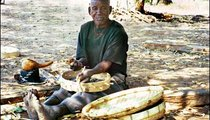 Mr. Mbodza, one of the oldest men in Gumira, tells old stories about water while he makes traditional crafts. Here he is making drums. He must soak the wood in water in order to work with it. To make most of his crafts, he has to use water for soaking reeds, wood, and other materials.