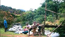 Children often play in the river or near it when the weather is hot. These local children are playing by a footbridge across the Nyamtikwa River.