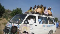 Girls with freshly braided hair on a van coming back from the big prayer.